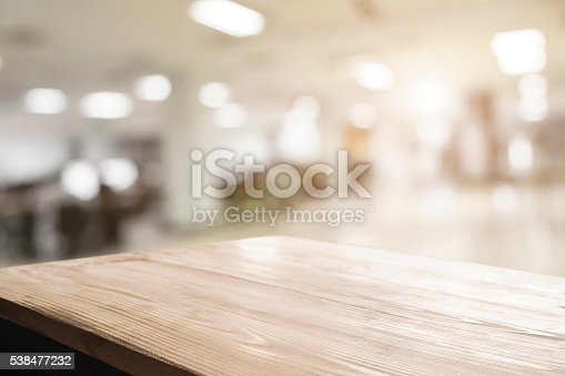istock Space of desk over blur cafe background 538477232