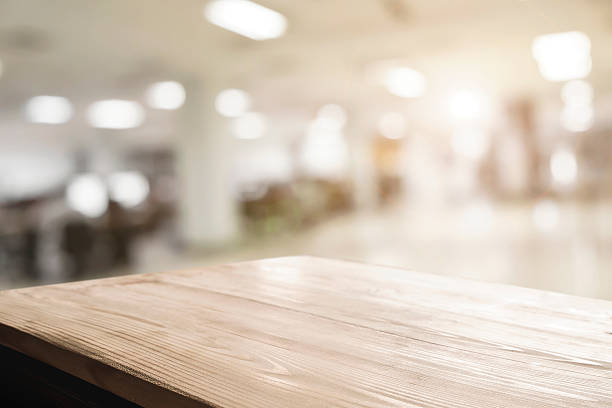 Space of desk over blur cafe background Empty wood table and blurred bokeh cafe light background. product display template. Business presentation. table stock pictures, royalty-free photos & images