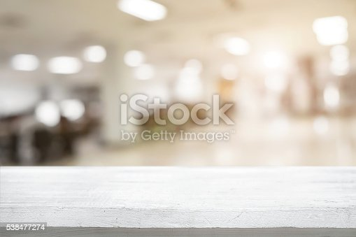 istock Space of desk over blur cafe background 538477274