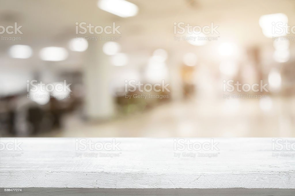 Space of desk over blur cafe background stock photo
