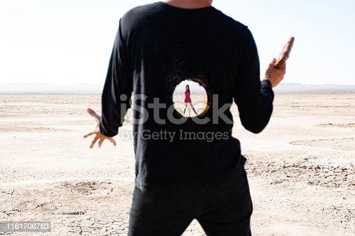 Man with a hole through chest after a laser gun shootout