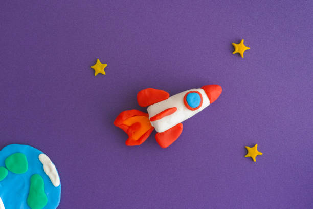 Space Rocket Blasting Off For New Ideas Space Rocket Blasting Off For New Ideas. Earth, space rocket and stars are made out of play clay (plasticine). clay stock pictures, royalty-free photos & images