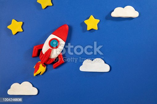 Start up concept with space rocket on blue background