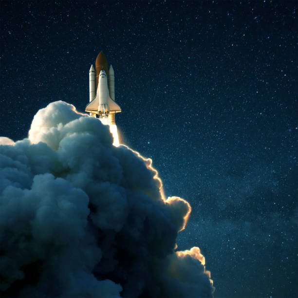 Space rocket launches into space against a starry blue sky. Ship shuttle with clouds of smoke Space rocket launches into space against a starry blue sky. Ship shuttle with clouds of smoke rocket stock pictures, royalty-free photos & images