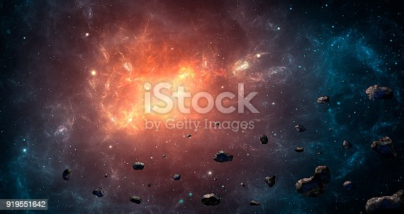 istock Space scene. Blue and orange nebula with asteroids. https://www.nasa.gov/multimedia/imagegallery/image_feature_1925.html 919551642