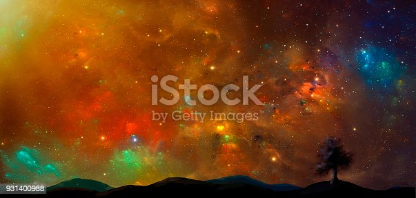 istock Space scene.Colorful nebula with land and tree silhouette. https://nasa3d.arc.nasa.gov/detail/as10-34-5013 931400988