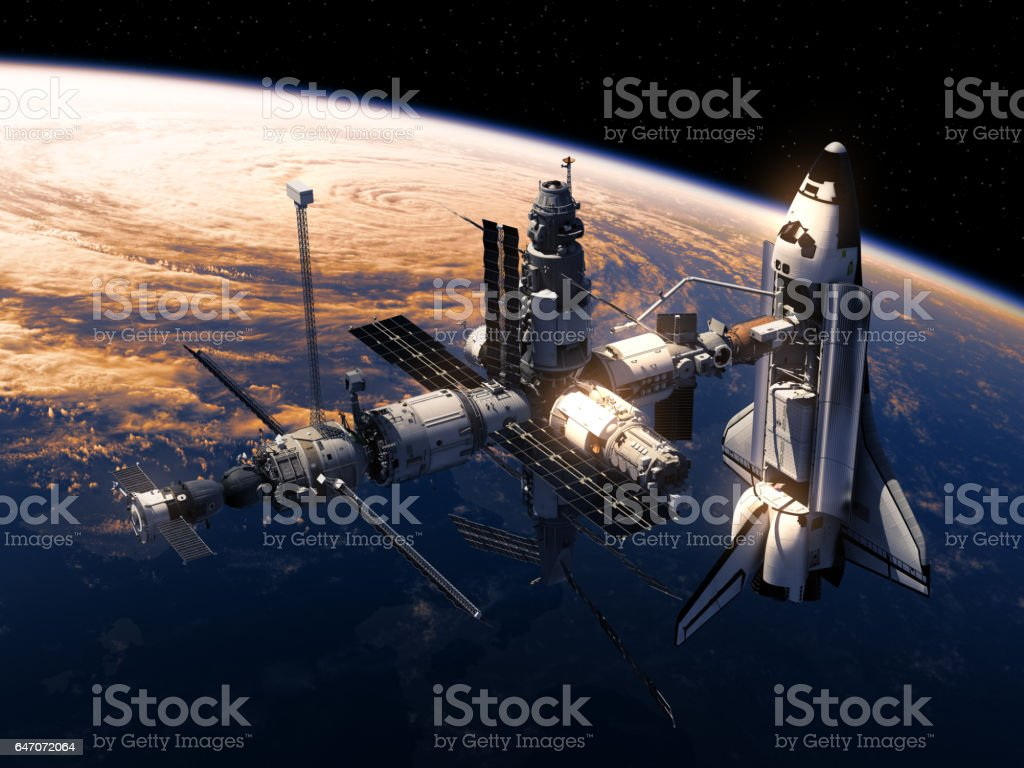 Space Shuttle And Space Station Orbiting Earth stock photo