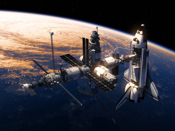 space shuttle and space station orbiting earth - space exploration stock photos and pictures