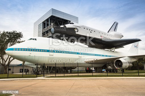 Houston: The Shuttle Independence sits atop the Shuttle Carrier Aircraft with JSC and Rocket Park in the background at Space Center Houston USA.  Space Center Houston is an educational center highlighting all eras of U.S. space travel via exhibits, tours & attractions.
