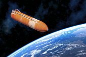 istock Space Shuttle External Tank Above Planet Earth 1029203850