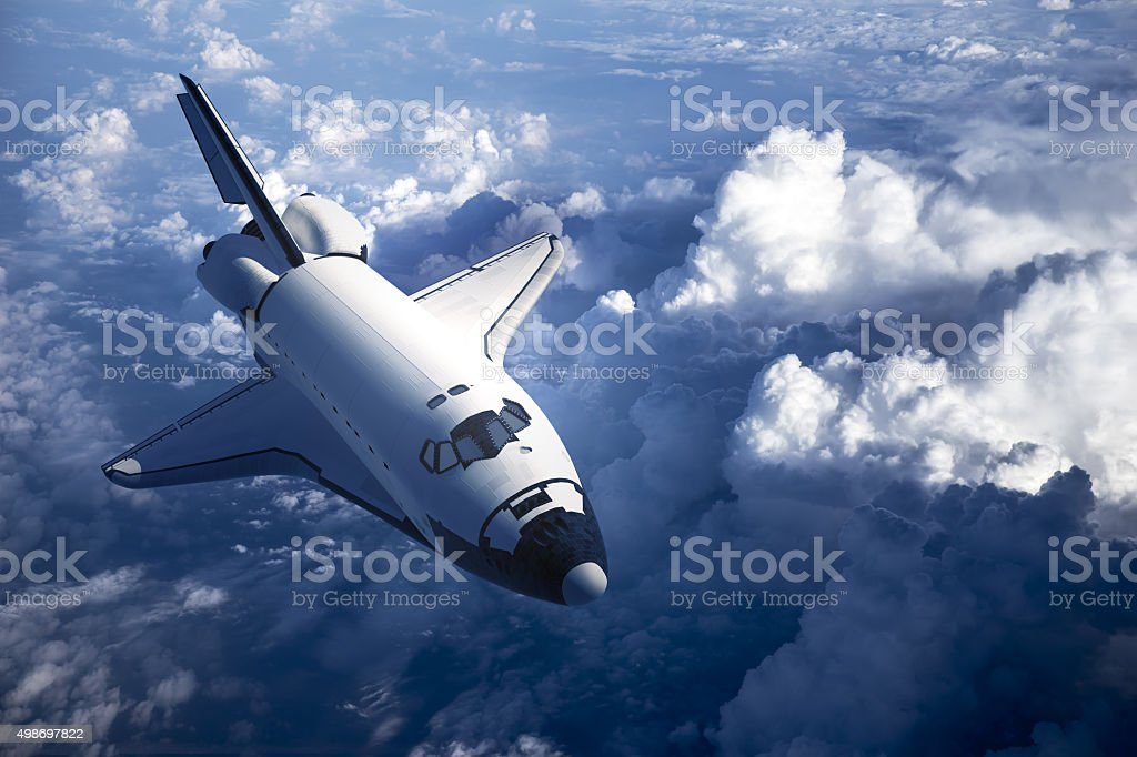 Space Shuttle Landing In The Clouds stock photo