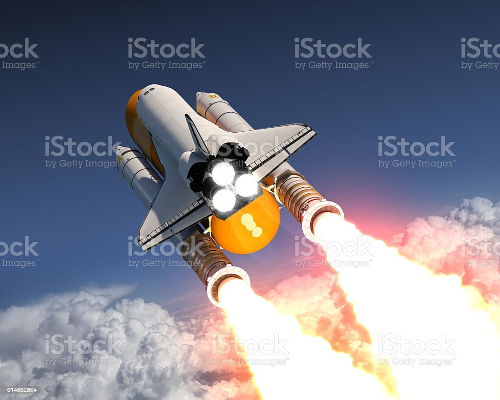 Space Shuttle Launch Above The Clouds stock photo