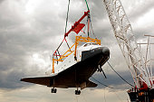 A space shuttle on the crane getting retired
