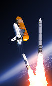 istock Space Shuttle Solid Rocket Boosters Separation Over Clouds 943404476
