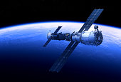 istock Space Station And Spacecraft Orbiting Blue Planet 1071063588
