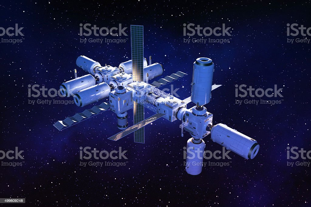 Space station floating in outer space on a star field stock photo