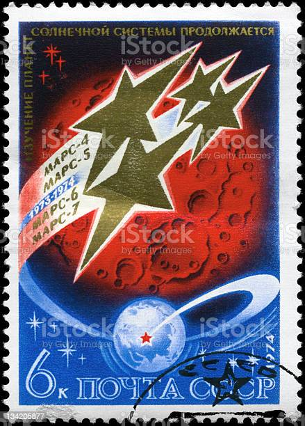 A Stamp printed in USSR shows the Space Stations Mars 4-7 over Mars, circa 1974