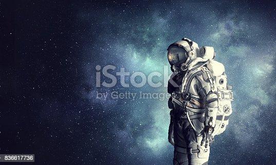 Spaceman wearing astronaut suit outdoor. Mixed media