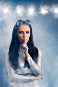 istock Space Woman in Silver Costume Holding a Secret 537334906