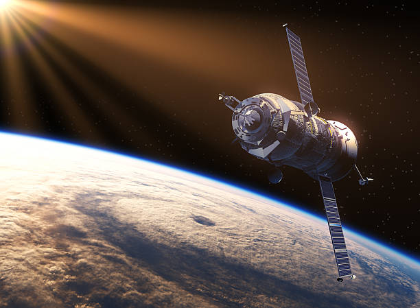 spacecraft in the rays of sun - satellite view stock pictures, royalty-free photos & images