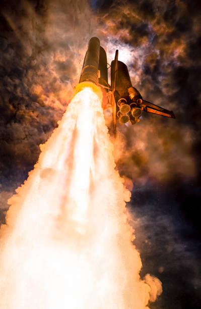 Spaceship launch at night, low-angle perspective. The elements of this image furnished by NASA. Spaceship launch at night, low-angle perspective. The elements of this image furnished by NASA. rocket stock pictures, royalty-free photos & images