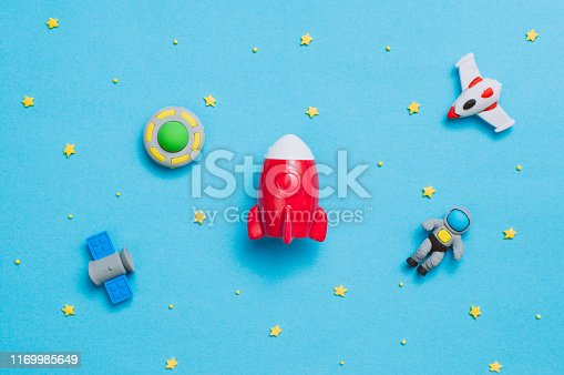 istock Spaceship, rocket, astronaut, UFO toys on blue background with copy space 1169985649