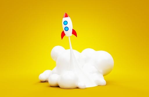 istock Spaceship startup rocket in the yellow background. Successful launch concept of business. 3d render illustration. 989564810