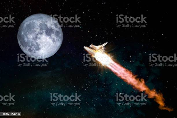 Photo of Spaceship taking off on a mission to the Moon, conceptual travel to the moon collage. Rocket flying in the space with fool moon. Elements of this image furnished by NASA.