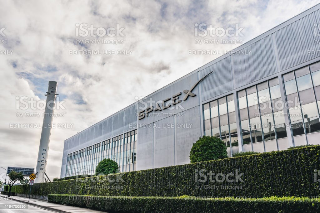 SpaceX headquarters Dec 8, 2019 Hawthorne / Los Angeles / CA / USA - SpaceX (Space Exploration Technologies Corp.) headquarters; Falcon 9 rocket displayed on the left; SpaceX is a private American aerospace manufacturer Aerospace Industry Stock Photo