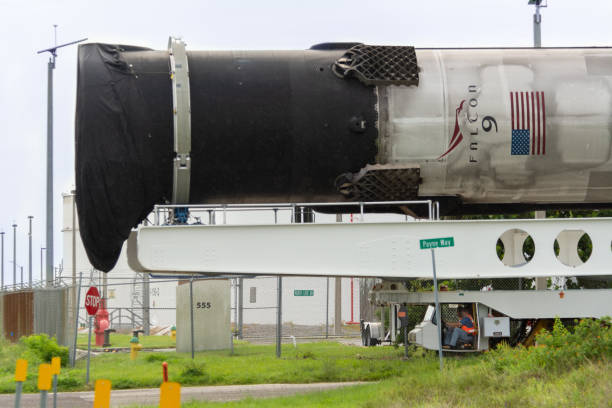 SpaceX Rocket being moved over road by transporter.