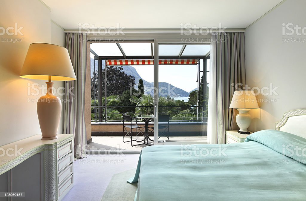 A Spacious And Comfortable Bedroom With A Nice View Stock