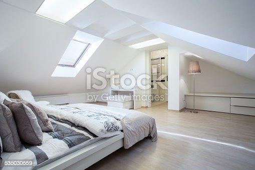 istock Spacious and fashionable bedroom 535030559