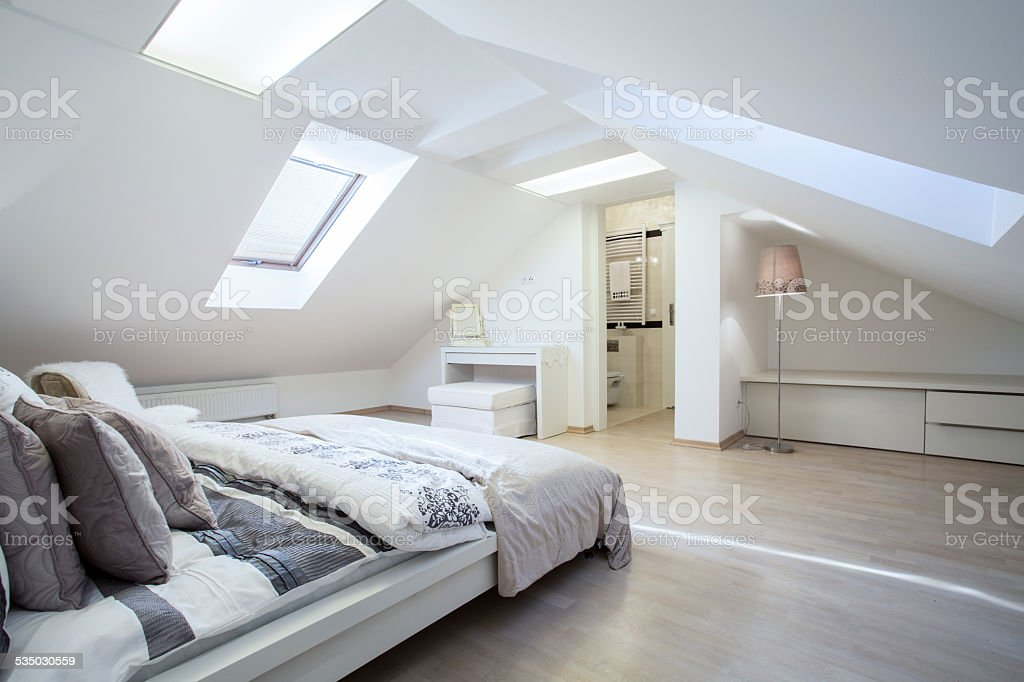 Spacious and fashionable bedroom stock photo