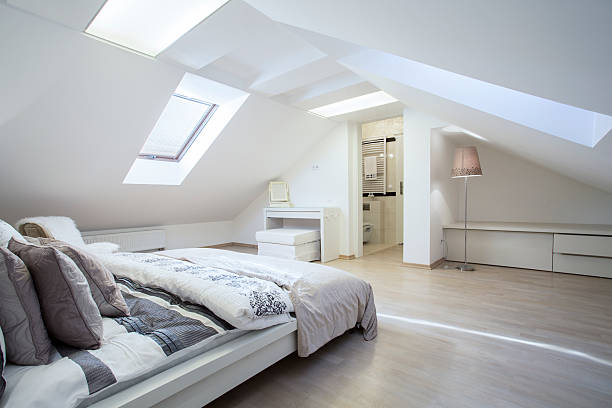 spacious and fashionable bedroom - loft apartment stock pictures, royalty-free photos & images