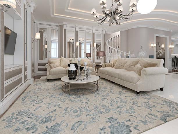 geräumige und luxuriöse wohnzimmer - wandleuchte treppenhaus stock-fotos und bilder