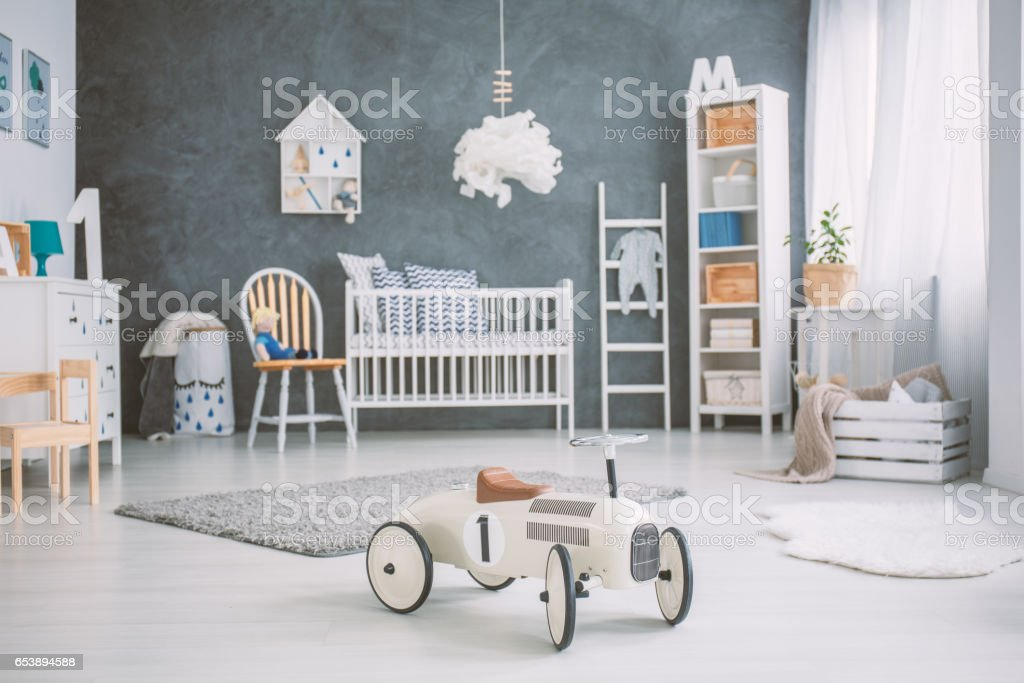 Spacious baby room with cot stock photo