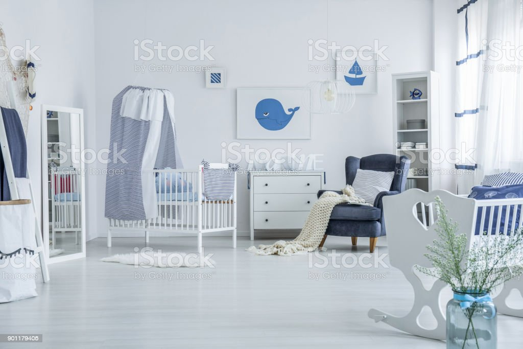 Spacious baby's room with crib stock photo