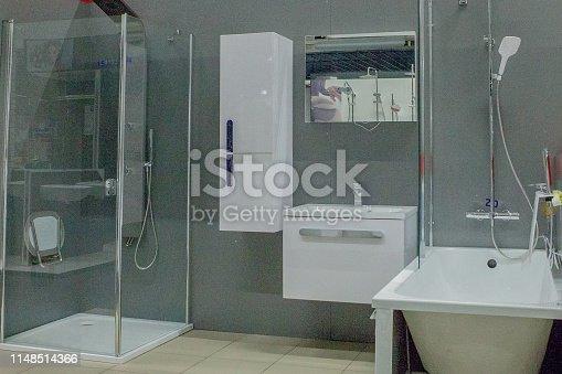 istock Spacious bathroom in gray tones with freestanding tub, walk-in shower, double sink vanity 1148514366