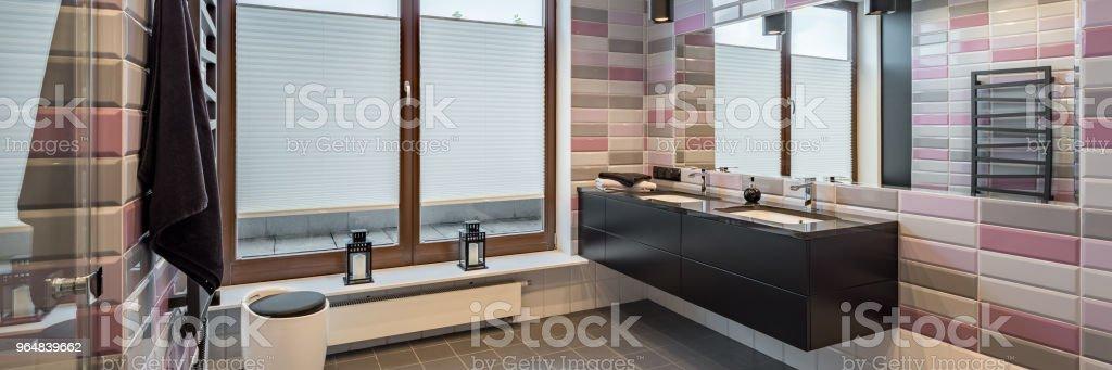 Spacious bathroom with brick tiles royalty-free stock photo