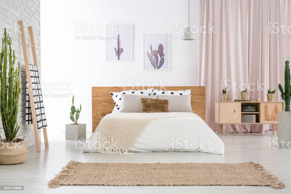 Spacious bedroom with cactus motif stock photo
