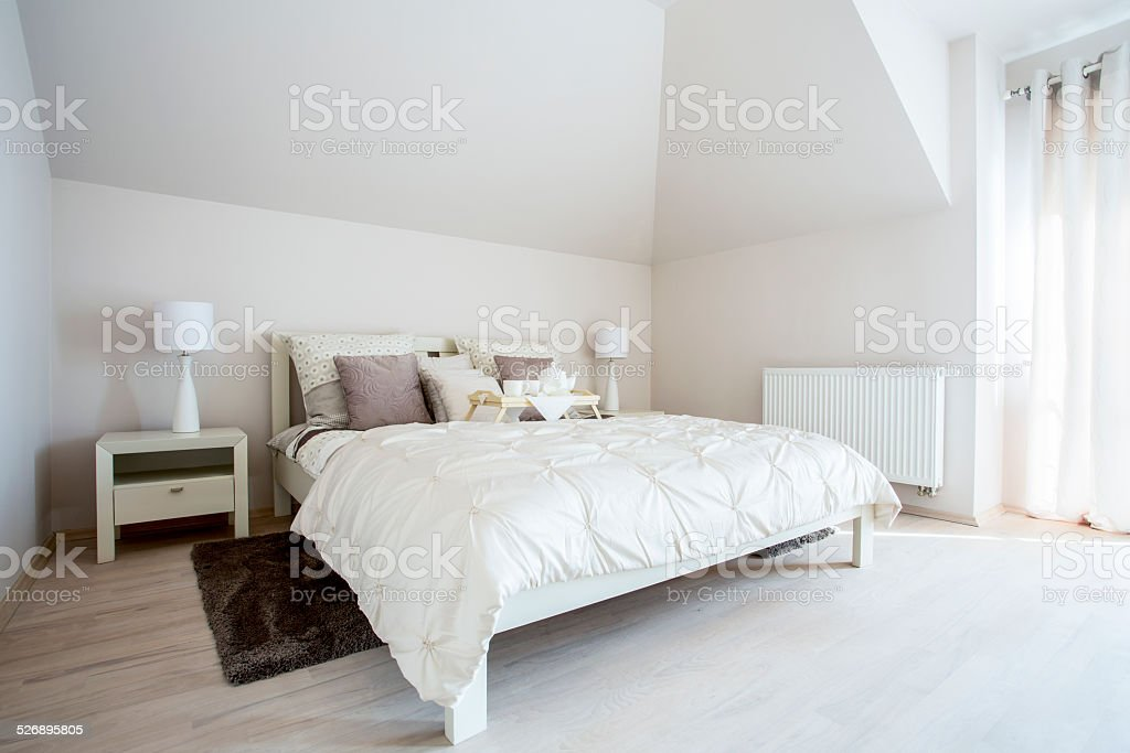 Spacious bedroom with twin bed stock photo