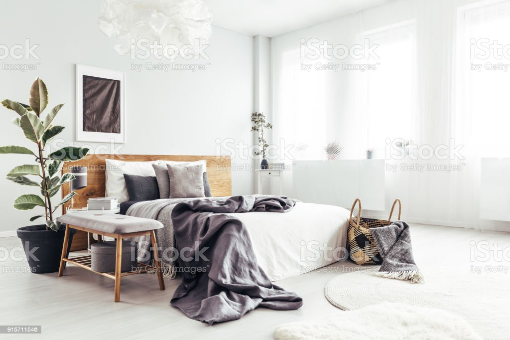 Spacious bedroom with windows stock photo