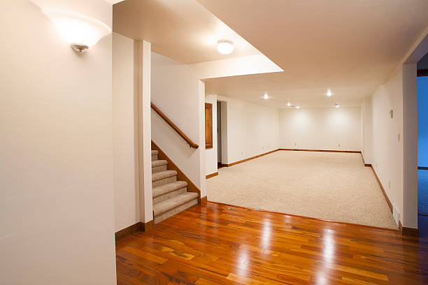 Spacious Finished Basement with Carpet and Hardwood Floors stock photo