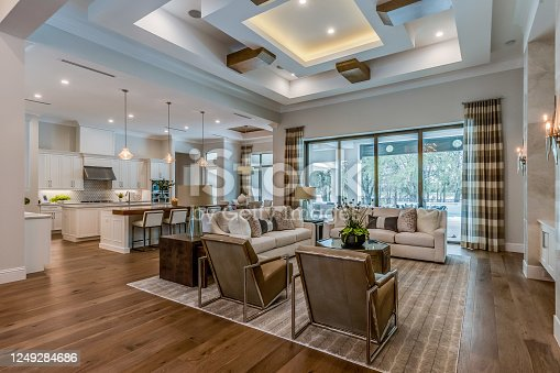 Open floor plan with high ornate coffered ceilings