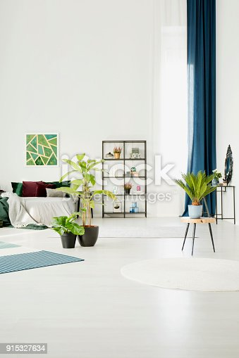 istock Spacious green bedroom interior 915327634