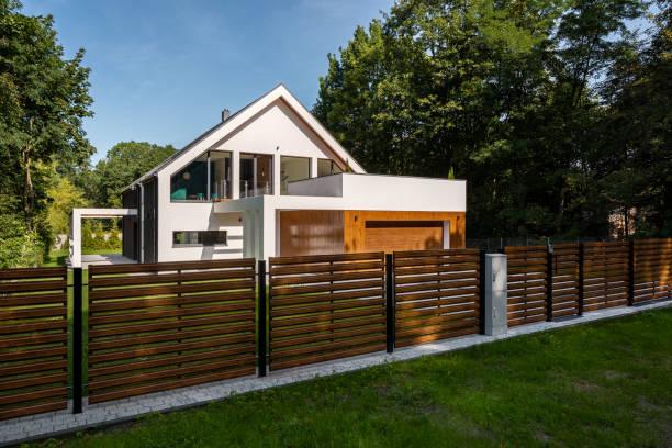 spacious house with garage - staccionata foto e immagini stock