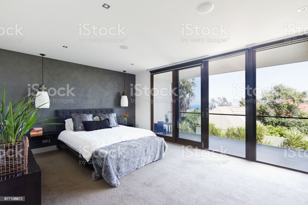 Spacious interior of designer master bedroom in luxury Australian home圖像檔