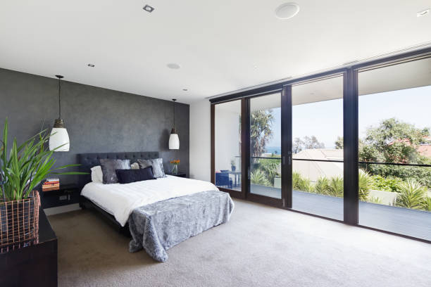 Spacious interior of designer master bedroom in luxury Australian home stock photo