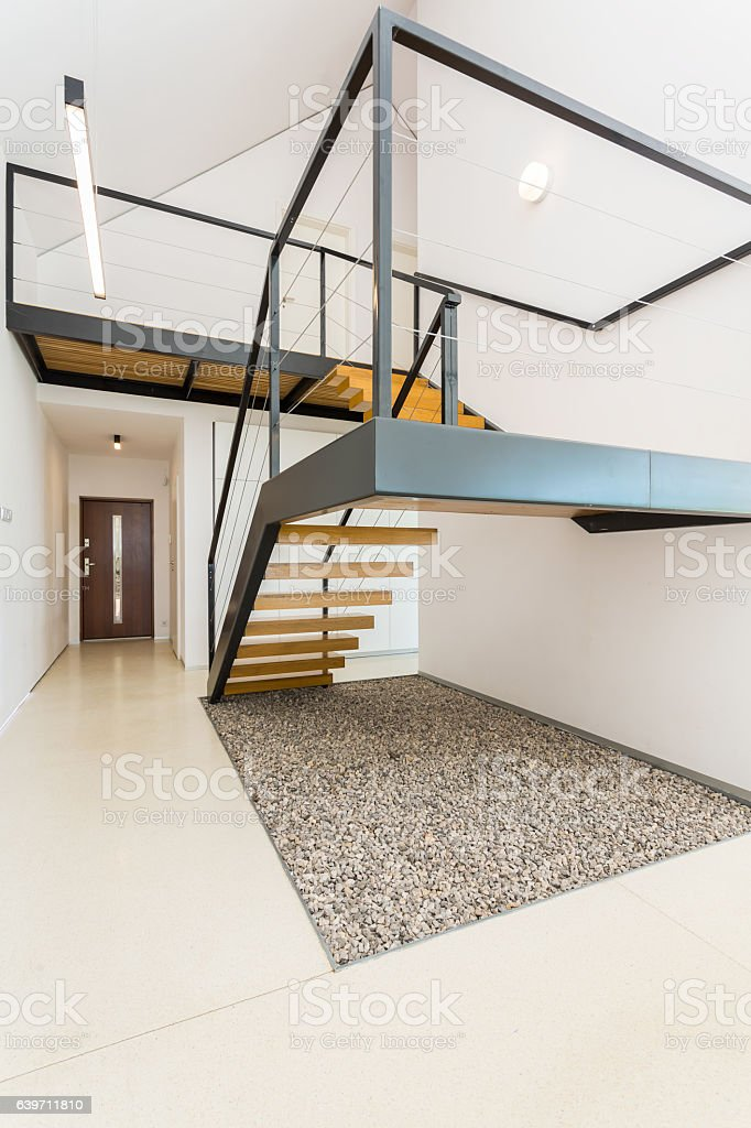 Spacious interior with mezzanine stairs stock photo