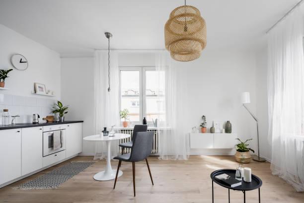 Spacious kitchen interior with table stock photo